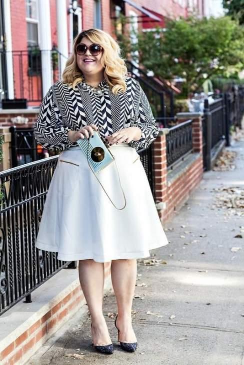 Nicolette khoe vẻ nữ tính với váy midi trắng và sơ mi phối màu.